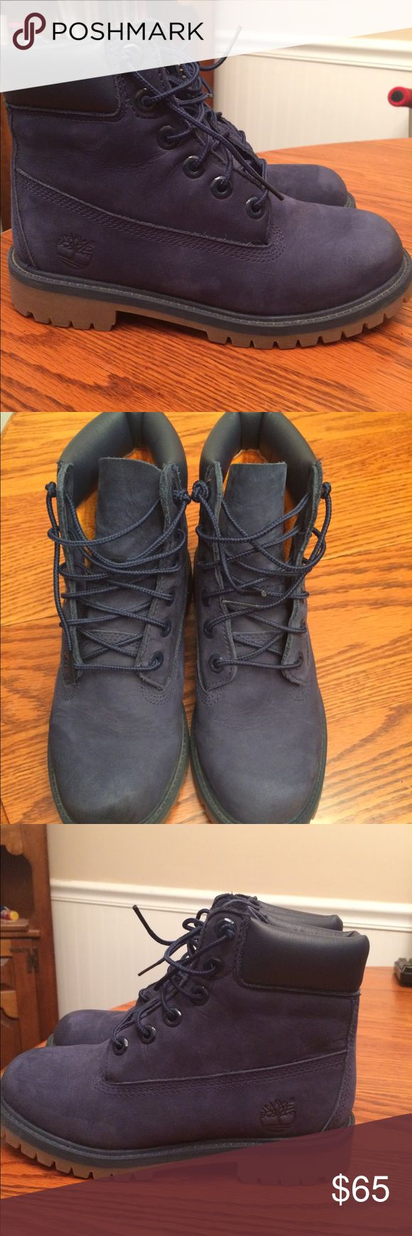 Grade School Timberland Boots Hardly worn Navy Blue Timberland Boots. No creasing, Close to brand new. Size 4 Timberland Shoes Boots