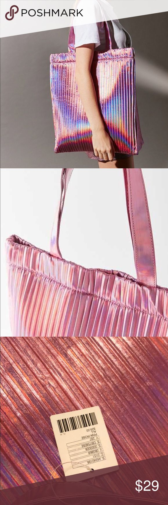 URBAN OUTFITTERS PLEATED TOTE BAG IN COLOR PINK When that minimalist lifestyle just isn't cutting it, pile all your necessities into this seriously luxe, pleated tote bag. Urban Outfitters Bags Totes