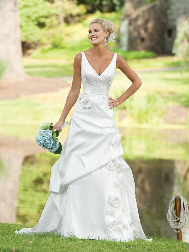 V-neck A-line taffeta bridal gown. I LOVE the top half of this dress!!!