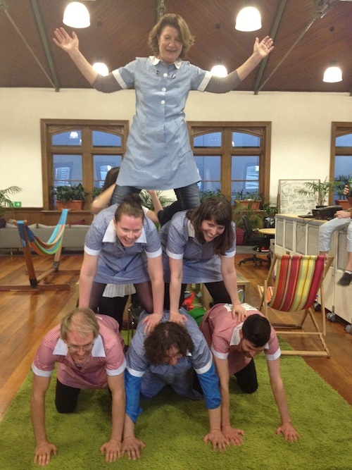 Human pyramid in dress. One of our weekly challenges.