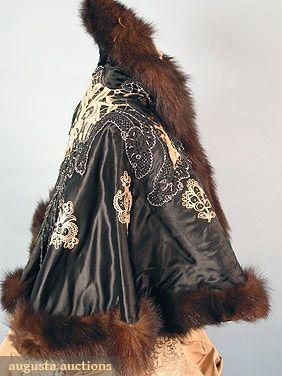 "BEADED SATIN CAPE, 1890s Black satin w/ ecru lace applique, jet & cut steel beads, fur trim, L 18"", Hem C 105"""