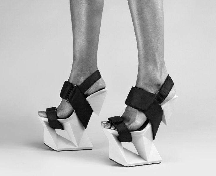 United Nude once again teams up with 3D systems to create a unique 3D printed 'Ice' shoe. Balancing at a height of 21 cm (eight inches), the shoes were designed as if they were sculpted from a block of ice. Using the 'Cubepro' desktop printer, the sculptural wedges are made from PLA filament that gets combined with a stitched leather finish.