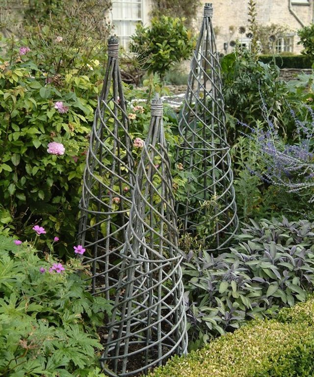 Architectural but still rustic, obelisk plant climbers provide a dramatic vertical element. via http://remodelista.com/ #home #design #lawn #garden #landscaping #plants