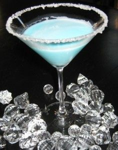 Silent Night Martini!: 1/4 c. Malibu Rum, 1/4 c. pineapple juice, 1/8 c. blue curacao, 1/8 c. white creme de coacoa, dash or two of whipping cream~ rim a martini glass with sugar, add all ingredients with ice- shake and pour