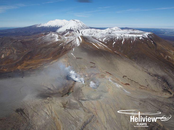The active Te Maari Crater with the three volcanoes Mt Tongariro, Mt Ngauruhoe and Mt Ruapehu beyond.