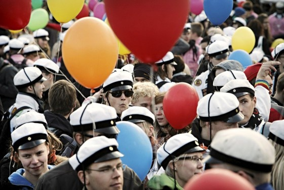 Vappu / May Day celebrations, the white hats are high school graduation hats, that you wear only on may 1st. Long time ago that day was the first day when graduates started to wear the hat for the whole summer, and in september there was another party when they stop using it.