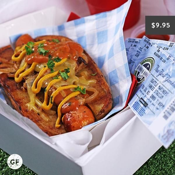 YouFoodz | American Spud Dog $9.95 | We're serving up a flavour packed kransky between a potato bun...yes that's right, we've given this dish a healthy twist by replacing the bread with some roasted spuds and topped with all your faves like caramelised onion + cheese and a ketchup-y pickle sauce | #Youfoodz #HomeDelivery #YoullNeverEatFrozenAgain