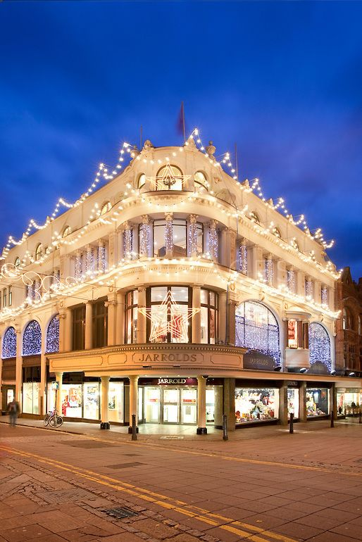 Jarrold's Department Store illuminated at Christmas, on the corner of Exchange Street and London Street in Norwich City centre. Jarrold's is one of the few independent department stores left in the country, and is much beloved by citizens. | chris Herring via Loop Images