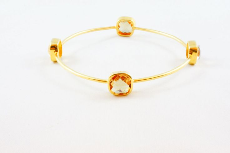 Smoky Quartz Gem Bangle - Sterling Silver 24kt gold micro plated bangle decorated with 4 square Smoky Quartz gem stones. Wear them Stack on or single. Perfect from day to night