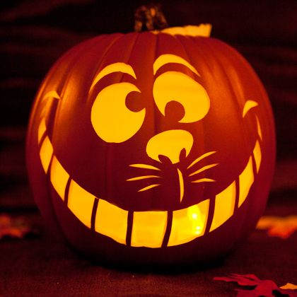 Welcome trick-or-treaters with the Cheshire Cat's cynical smile.:
