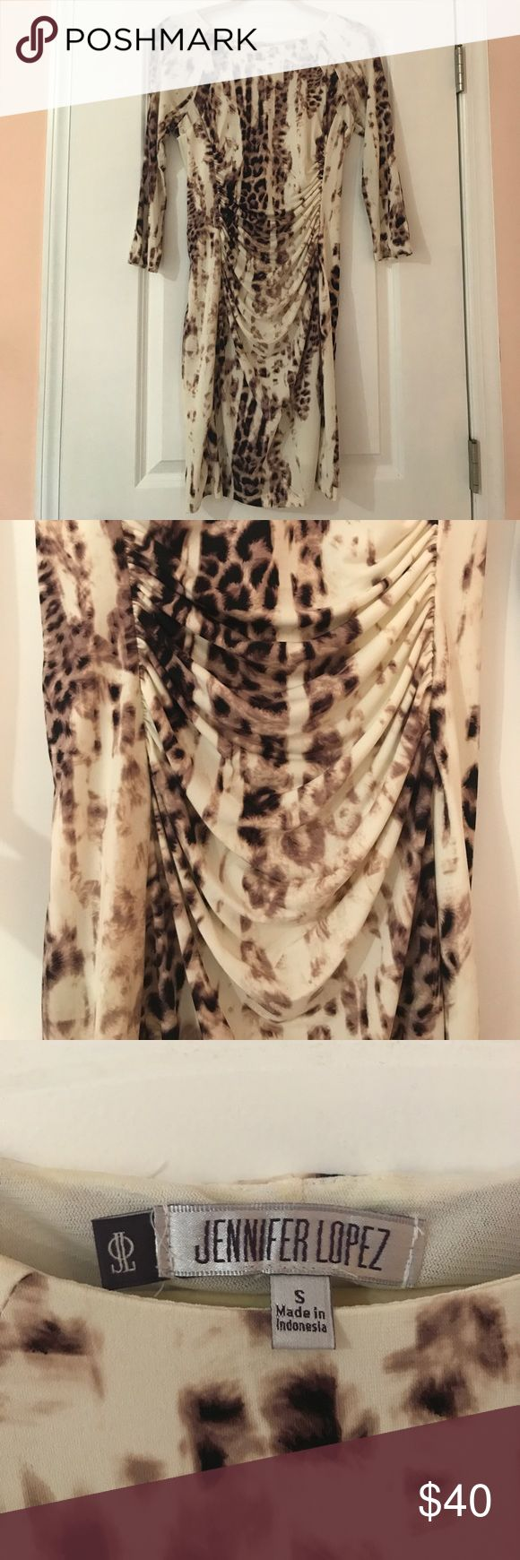 Jennifer Lopez Multi Color Animal Print Dress Only worn once. Kept in excellent condition. Really cute and comfortable! Has a stretchy feel to it so it could fit a medium as well. For reference: I'm 5 feet tall and this hits about knee length. Jennifer Lopez Dresses