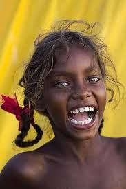 A beautiful native Australian young lady with laughing eyes.