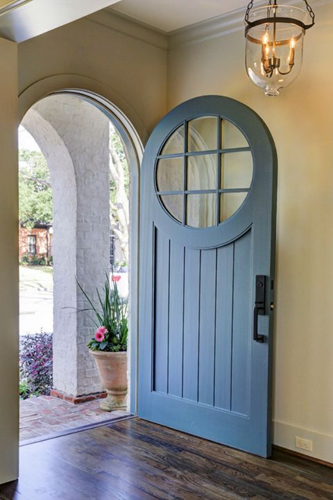 This round top door is the perfect addition to a Craftsman home.