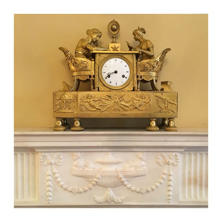 "George F. Baker Houses ~ Carnegie Hill - 1928-31 - Delano & Aldrich - 67-69 East Ninety-Third Street ~ Library at 67 - French Mantel Clock - ""The Astronomy Lesson"" designed by Jean-Andre Reiche, made by Dlaude Galle, circa 1810, gilt bronze. This clock depicts an astonomy lesson between a mother & daughter. Feale scholarship was a favored motif of Reiche's: he produced several clock designs with women reading & studying. ~ (Photo by  Patrick Derosier 