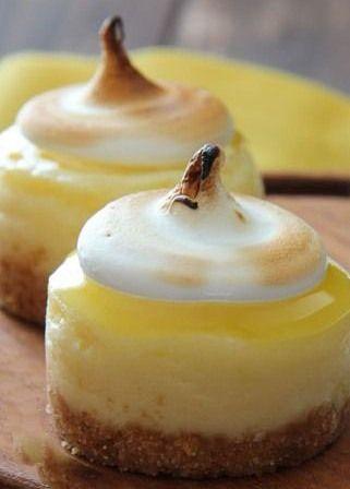 Mini Lemon Meringue Cheesecakes~ mini lemon cheesecakes topped off with fresh lemon curd and meringue. A perfect bite sized Spring dessert!