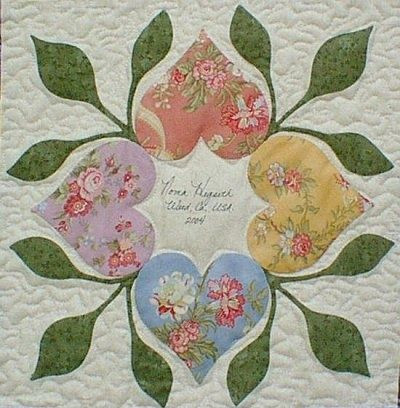 A quilt block with white space in the middle, as a label (The Heart Circle Quilter's Retreat)