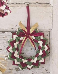 Starry Night Ornament: A Quick and Easy Project for Scraps – No Sewing Required! = This is made with small squares of fabric folded and pinned to a small Styrofoam wreath. Great way to use leftover fabric. You could use larger scraps with a larger Styrofoam wreath base.