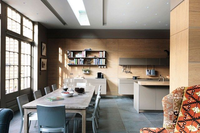 Browse hundreds of kitchen images to design your dream kitchen. This modern kitchen from Bulthaup by Kitchen Architecture, has rough-sawn oak walls and Philippe Starck chairs.