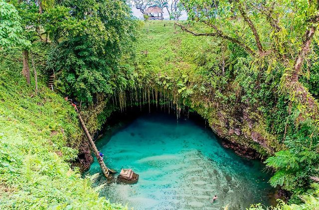 "Dubbed by some as the ""most magical swimming pool in the world,"" To Sua Ocean Trench is a site that has to be seen to be believed. The grotto is located in Lotofaga village, on Upolu island in..."