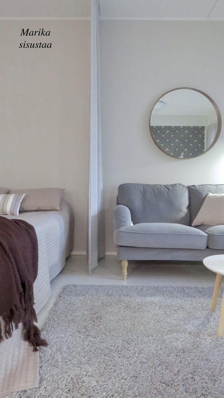Harmaan ja beigen sävyt pitävät tämän  kodin värimaailman harmonisena. Olohuone, makuuhuone ja ruokailutila yhtä tilaa.