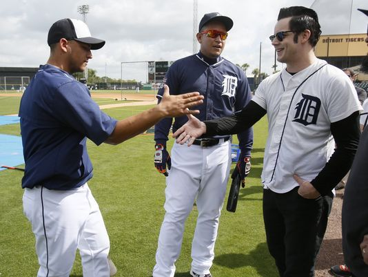 Detroit Tigers Jose Iglesias, left, shakes hands with musician and Detroit native Jack White after Iglesias was introduced by Miguel Cabrera, center, before their game today in Lakeland, Fla. (Photo: Julian H. Gonzalez, Detroit Free Press)
