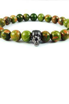 Dizarro to męska biżuteria najwyższej jakości produkowana z kamieni półszlachetnych, srebra, złota oraz kryształów Swarovski™.  Bransoletka wykonana z jaspisów oraz srebrnej, rutenowanej czaszki.Szczegóły:- czaszka z rutenowanego srebra próby 925- bransoletka wkładana na elastycznej gumce- średnica kulek: 8 mm- bransoletka zapakowana w eleganckie, czarne pudełko
