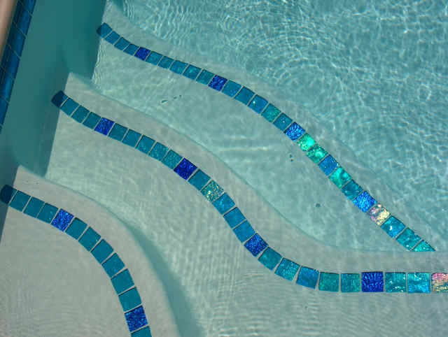 Cool Method Of Accenting Your Pool Steps Might Be A Good