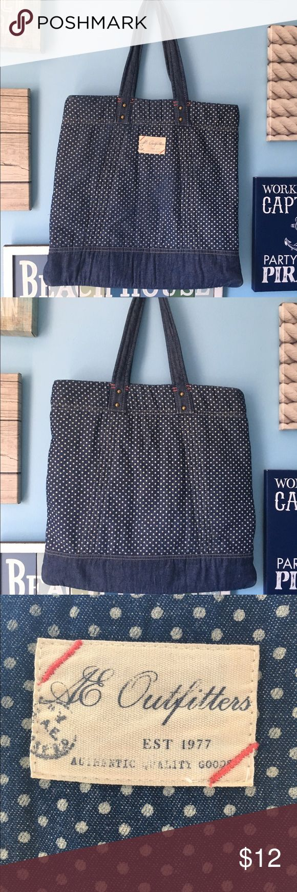 American Eagle Polka Dot Tote Bag Navy and white polka dot bag that's perfect for spring 🌸😌🌸 has straps on the inside to tie down anything you don't want escaping. Slight fading on the front, but not very noticeable American Eagle Outfitters Bags Totes