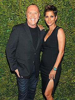 """Halle Berry, Michael Kors - """"Berry, 46, and designer, 53, have created two versions of Kors' Runway watch. For each watch sold (the designs go on sale later this month), 100 meals will be provided to children through the World Food Programme."""""""