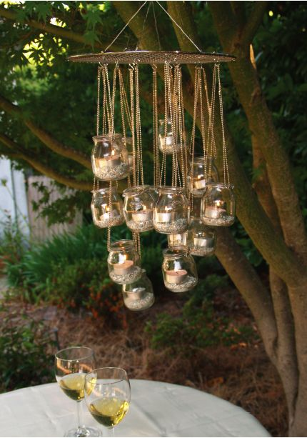 Here's a simple DIY garden chandelier tutorial from Ecologue. It's a great way to reuse little glass jars you may already have at home.