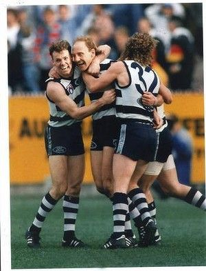 Michael Mansfield and Garry Hocking celebrating with Gary Ablett Snr after he kicks a match-winning goal.