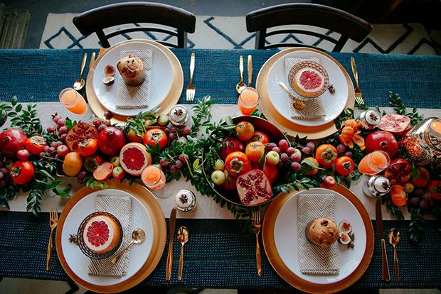 A festive and fruity tabletop - Create a runner of winter fruits to create a gorgeous, colorful (and edible!) tablescape.
