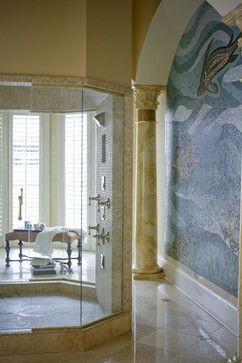 This Greek-inspired bathroom includes an ocean-themed mosaic and elaborate pillar to create an international feel.