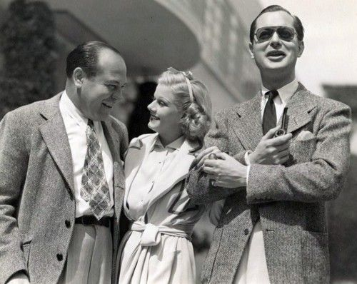 Outside the Star Dressing Room building in 1937. I believe that's Eddie Mannix on JH's left. Robert Montgomery is behind those sunglasses.
