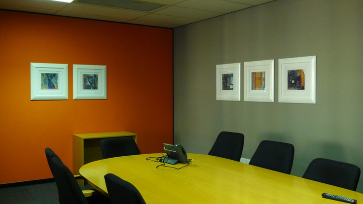group artwork to create interest - the white frames brighten up a room with no natural daylight