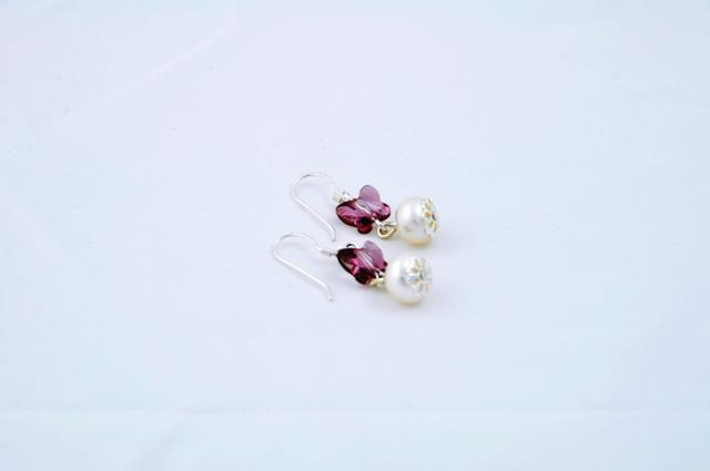 silver earrings with pearl and a beautiful swarovski butterfly