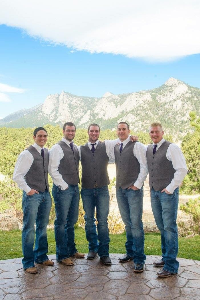 Estes Park, Colorado mountain wedding. Rustic groomsmen attire. Jeans and vest in wedding day.