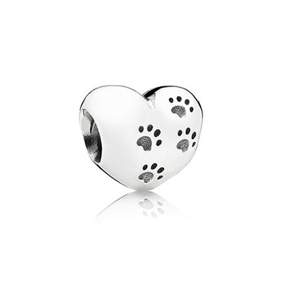 """The classic PANDORA sterling silver heart is now available with cute paw print details and """"My sweet pet"""" engraved. $40 #PANDORAcharm #SpringCollection #SS14"""