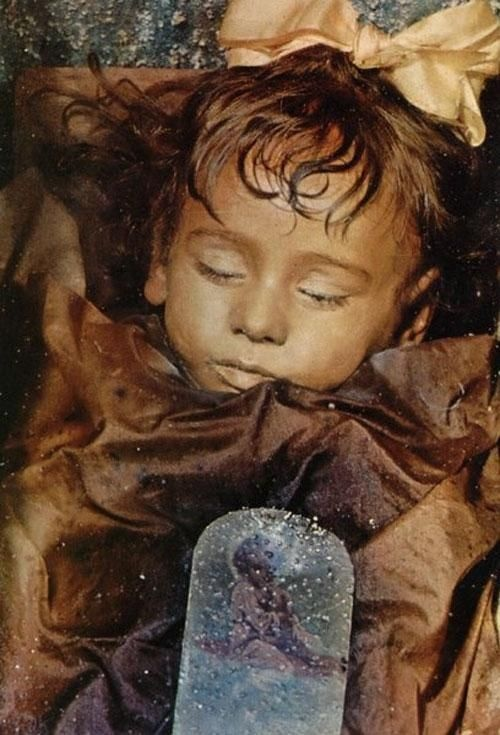 Rosalia Lombardo was an Italian child born in 1918 in Palermo, Sicily. She died of pneumonia on December 6, 1920. Rosalia's father, General Lombardo, was sorely grieved upon her death, so he approached Alfredo Salafia, a noted embalmer, to preserve her. Her body was one of the last corpses to be admitted to the Capuchin catacombs of Palermo in Sicily.The mummy is one of the best preserved bodies in the catacombs.