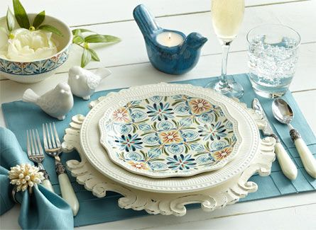 Aqua and cream place setting with natural and bird theme for a pretty brunch.