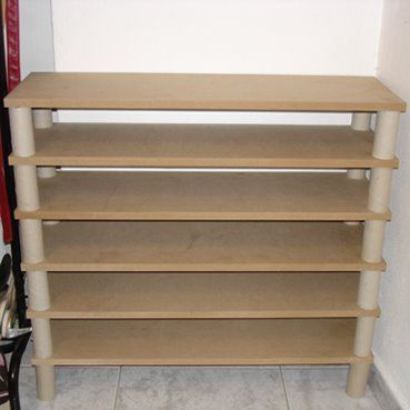 MDF boards +toilet paper cardboard cylinders= shoe storage  you could sand the shelves  paint this to suit your tastes ~ Kel: