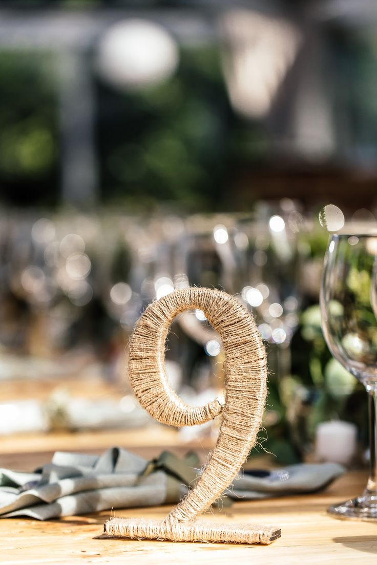 Rustic table numbers - wrapped in natural-coloured yarn - www.weddingconcepts.co.za