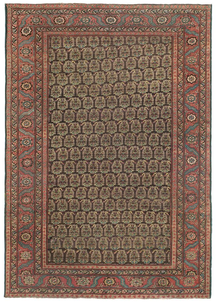 "Bakshaish, 7ft 0in x 10ft 0in, Circa 1875.  Of avid interest to connoisseurs, this singular room size Persian Bakshaish antique carpet offers much-loved traditional motifs with a surprising palette of warm, time-softened natural colors. In this rarely encountered piece, undyed, dark brown sheep's wool is an unique base to the field's compelling all-over pattern, where golden botehs (""Seed of Life"" motifs) shimmer in mesmerizing detail."