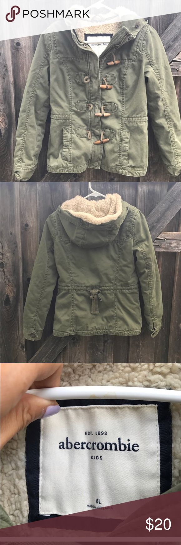 Abercrombie girls jacket Abercrombie Kids army green thick winter jacket size Xl  No stains or rips  Only thing missing is the fur on the hood  Length 23 inches  Armpit to armpit 18 inches  Shoulder to shoulder 14 inches  Length of arm from shoulder 26 Jackets & Coats
