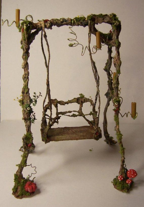 For your 1/12 scale fairy/witch outdoor scene is that swing the perfect addition.    The swing, mushrooms and eyes from polymere clay,real candels and