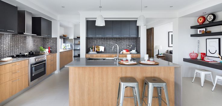 KITCHEN: Dramatic and resourceful this Kitchen is bold in colour and texture. Deep charcoal highlights and teak inspired timbers anchor this design to an otherwise minimalistic off white colour palette. Visit our Graphix Lookbook style here: http://www.metricon.com.au/get-inspired/lookbook/graphix
