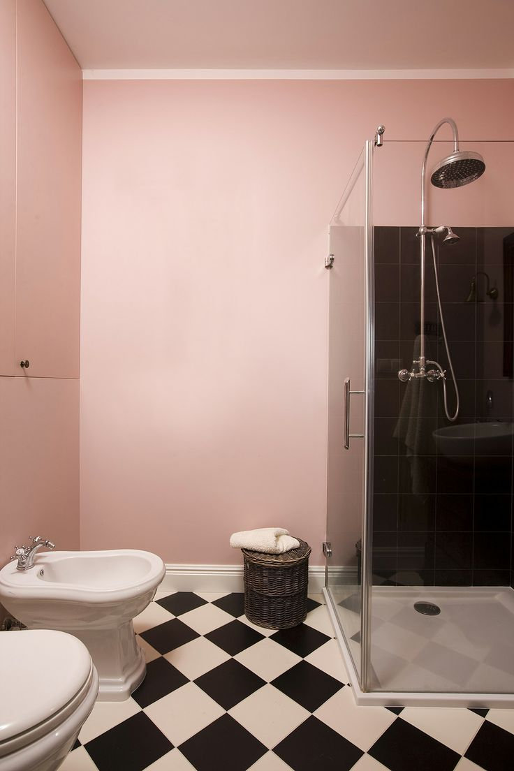 pink eclectic bathroom with black and white floor, checker floor, balck and white floor, black shower, pink bathroom, pastel pink bathroom