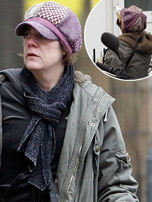 Ex soap star Elaine Lordan pictured downing wine in the street