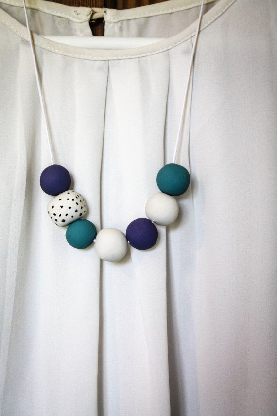 Handmade polymer clay necklace on white waxed cord. Scandi inspired blue, purple and white polymer clay. Shipping: NZ $3.5 International $10
