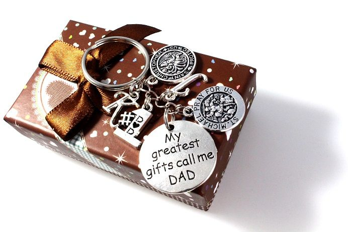 "This special Key Chain will come standard with the round 'St. Michael' & round 'My Greatest Gifts Call Me Dad' Charms...you may select FOUR ADDITIONAL charms such as initial charms for Dads children, sport charms (AWESOME for Coach Daddy), Jersey #'s and/or Religious Charms.  This handmade key chain is approximately 3.5"" from end to end - perfect for Dads Keys!"